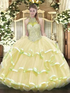 Light Yellow Ball Gowns Organza and Tulle Halter Top Sleeveless Beading and Ruffled Layers Floor Length Lace Up Quinceanera Gown