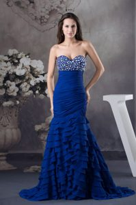 Beading and Ruffled Layers Decorate Prom Dresses in Royal Blue