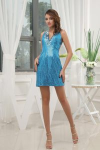 Gorgeous V-neck Blue Prom Gown with Sequin and Cutouts Back